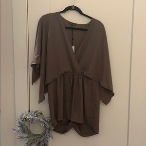 Cute new with tags cape romper size large